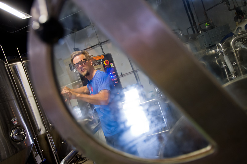 "Nate Luebbe takes a sample from the kettle while brewing at Upslope Brewing Company in Boulder on Thursday.<br /> More photos:  <a href=""http://www.dailycamera.com"">http://www.dailycamera.com</a><br /> (Autumn Parry/Staff Photographer)<br /> July 20, 2016"