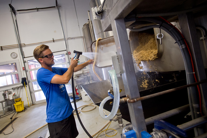 "Nate Luebbe, a technical brewer, empties malted barley out of the mash tun, while brewing at Upslope Brewing Company in Boulder on Thursday.<br /> More photos:  <a href=""http://www.dailycamera.com"">http://www.dailycamera.com</a><br /> (Autumn Parry/Staff Photographer)<br /> July 20, 2016"