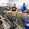 "Packaging Technicians Jared Funk-Breay (left) and Kyle Shurtz sort through cases of beer as they prepare to load them onto a pallet at Upslope Brewing Company in Boulder on Thursday.<br /> More photos:  <a href=""http://www.dailycamera.com"">http://www.dailycamera.com</a><br /> (Autumn Parry/Staff Photographer)<br /> July 20, 2016"