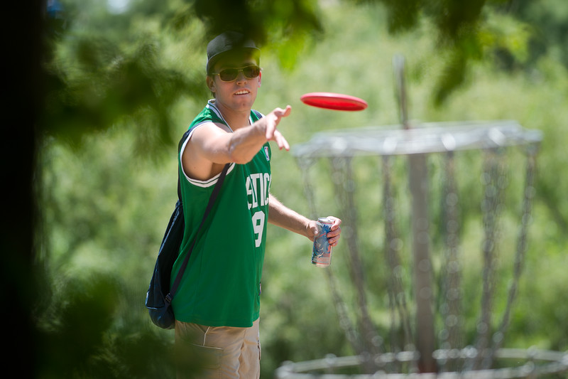 "Aleksei La Rue tosses the frisbee into the pole hole during a game of disc golf at Valmont Park on Saturday. There will be a disc golf tournament on Sunday as part of the fifth anniversary celebration at Valmont Bike Park. <br /> More photos:  <a href=""http://www.dailycamera.com"">http://www.dailycamera.com</a><br /> (Autumn Parry/Staff Photographer)<br /> June 11, 2016"