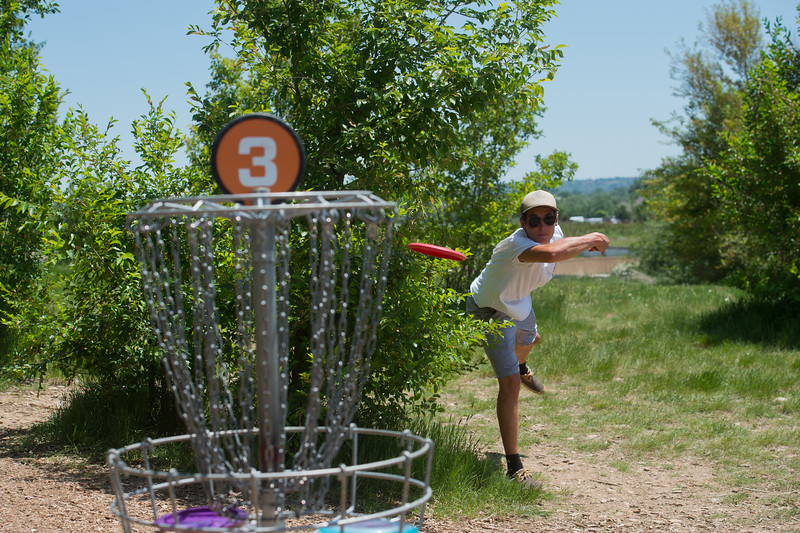 "Gavin Scharig tosses the frisbee into the pole hole during a game of disc golf at Valmont Park on Saturday. There will be a disc golf tournament on Sunday as part of the fifth anniversary celebration at Valmont Bike Park. <br /> More photos:  <a href=""http://www.dailycamera.com"">http://www.dailycamera.com</a><br /> (Autumn Parry/Staff Photographer)<br /> June 11, 2016"