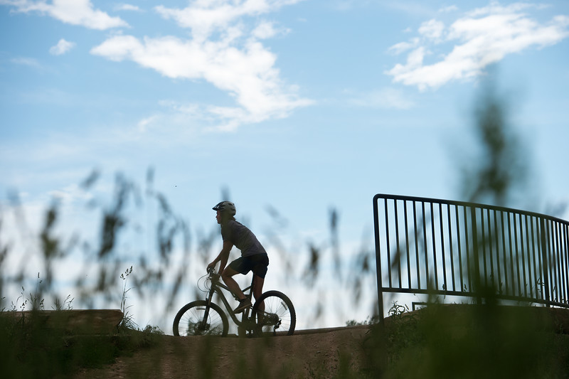 "Graham Palmer pauses before attempting jumps at Valmont Bike Park on Saturday. The City of Boulder Parks and Recreation Department celebrated the fifth anniversary of Valmont Bike Park this weekend. <br /> More photos:  <a href=""http://www.dailycamera.com"">http://www.dailycamera.com</a><br /> (Autumn Parry/Staff Photographer)<br /> June 11, 2016"