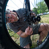"Joey Gallagher, a tech specialist II with REI, adjusts the air pressure in the front shock of a bike for a free demo, as part of Valmont Bike Park's fifth anniversary celebration on Saturday.<br /> More photos:  <a href=""http://www.dailycamera.com"">http://www.dailycamera.com</a><br /> (Autumn Parry/Staff Photographer)<br /> June 11, 2016"