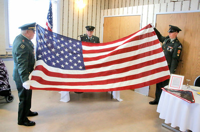 Mad River Community Veterans Honor Guard members Jim Blick, left, Lou Agliolo, and Greg Vincent demonstrate a flag folding ceremony as part of Humboldt Senior Resource Center's honoring veterans in Eureka on Friday. The honor guard performs the ceremony at veteran funerals and memorials. (Shaun Walker -- The Times-Standard)