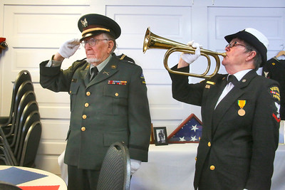 Mad River Community Veterans Honor Guard members Patsy Matthews and Warren Tindall play taps and salute as part of Humboldt Senior Resource Center's honoring veterans on Friday. The honor guard demonstrated a flag folding ceremony that it performs at veteran funerals and memorials. (Shaun Walker -- The Times-Standard)