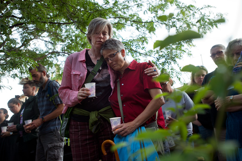 "Kris Abrams (left) and Lisa Martin pay their respects to the victims of the mass shooting at the gay nightclub Pulse in Orlando, Fla., during a vigil held in Boulder on Sunday.<br /> For more photos go to  <a href=""http://www.dailycamera.com"">http://www.dailycamera.com</a><br /> (Autumn Parry/Staff Photographer)<br /> June 12, 2016"