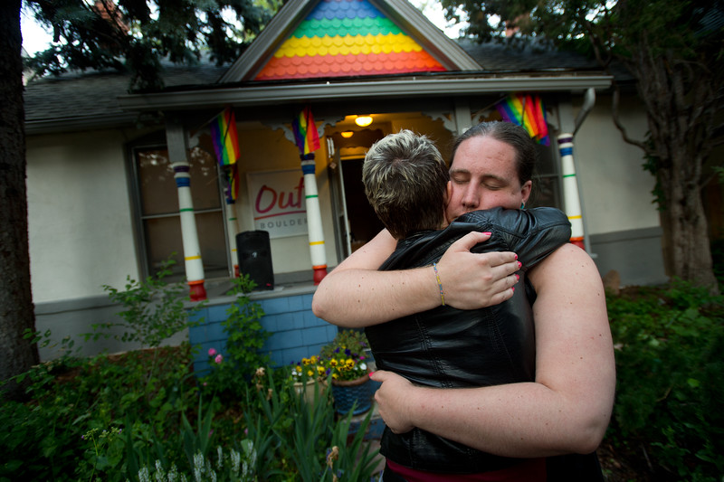 "Sara Connell, education and services manager for Out Boulder, hugs Leslie McCormick during a vigil held in Boulder for the victims of the mass shooting at the gay nightclub Pulse in Orlando, Fla. on Sunday.<br /> For more photos go to  <a href=""http://www.dailycamera.com"">http://www.dailycamera.com</a><br /> (Autumn Parry/Staff Photographer)<br /> June 12, 2016"