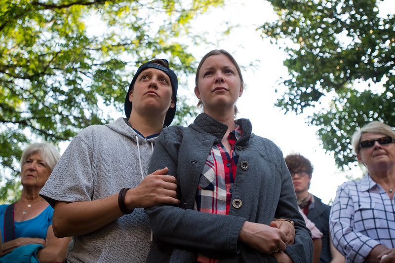 "Li Brookens and their wife Sarah Williams attend the vigil held in Boulder for the victims of the mass shooting at the gay nightclub Pulse in Orlando, Fla. on Sunday.<br /> For more photos go to  <a href=""http://www.dailycamera.com"">http://www.dailycamera.com</a><br /> (Autumn Parry/Staff Photographer)<br /> June 12, 2016"