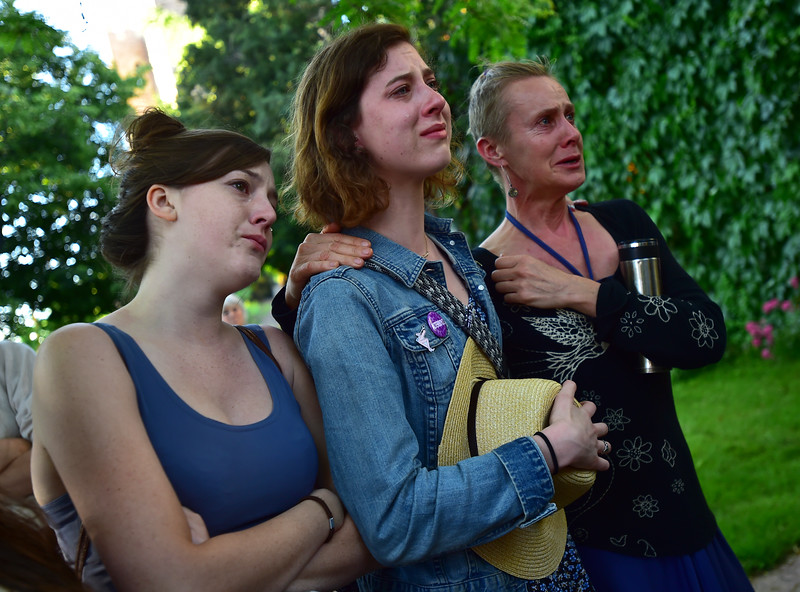 "From left to right, Alison Banowsky, Cat Abood, and Lucy Braham mourn the loss of the victims of the mass shooting at the gay nightclub Pulse in Orlando, Fla., during a vigil held in Boulder on Sunday.<br /> For more photos go to  <a href=""http://www.dailycamera.com"">http://www.dailycamera.com</a><br /> (Autumn Parry/Staff Photographer)<br /> June 12, 2016"