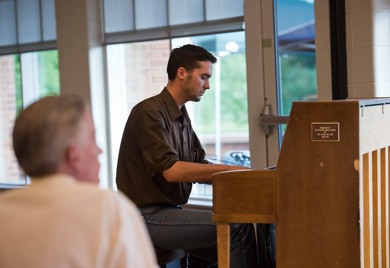 "Travis Lutz plays the piano during a vigil held for Peter Kim and Sarah Ball at East Boulder Community Center on Friday. Peter Kim and Sarah Ball were both victims of a fatal car accident on Sunday.<br /> More photos:  <a href=""http://www.dailycamera.com"">http://www.dailycamera.com</a><br /> (Autumn Parry/Staff Photographer)<br /> June 17, 2016"