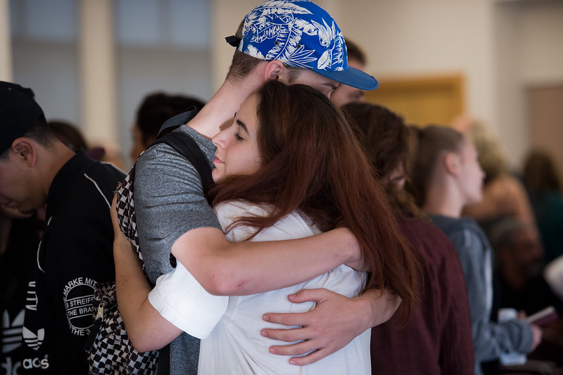 "Naomi Tari hugs Donovan Noland during a vigil held for Peter Kim and Sarah Ball at the East Boulder Community Center on Friday. Peter Kim and Sarah Ball were both victims of a fatal car accident on Sunday.<br /> More photos:  <a href=""http://www.dailycamera.com"">http://www.dailycamera.com</a><br /> (Autumn Parry/Staff Photographer)<br /> June 17, 2016"