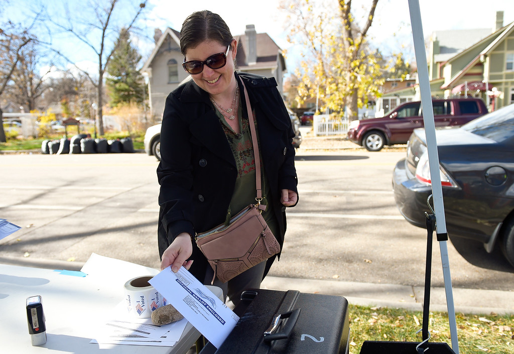 . LONGMONT, CO - NOVEMBER 5: Adrienne Kerstetter puts her ballot in the box at the ballot drop-off area along Terry Street outside the Boulder County St. Vrain Community Hub Nov. 5, 2018. (Photo by Lewis Geyer/Staff Photographer)