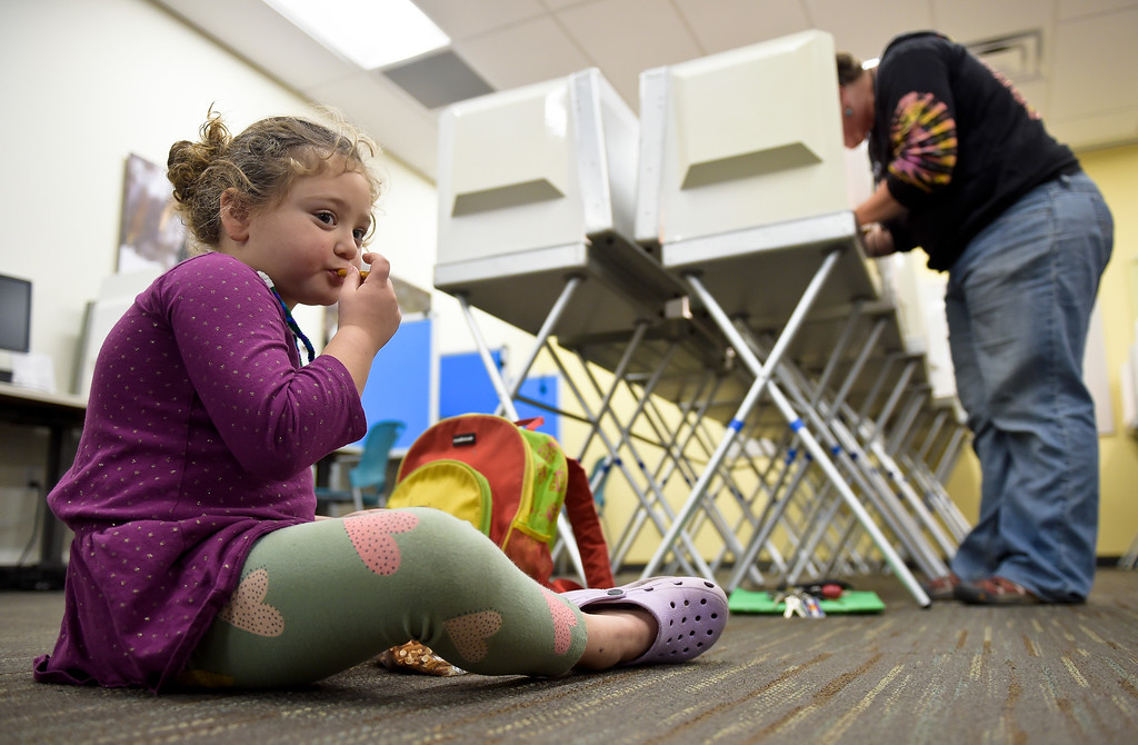 . LONGMONT, CO - NOVEMBER 5: Rosemary Ghiasi-Henrichon, 4, has a snack while her mother Elizabeth Henrichon votes at the Boulder County St. Vrain Community Hub Nov. 5, 2018. (Photo by Lewis Geyer/Staff Photographer)
