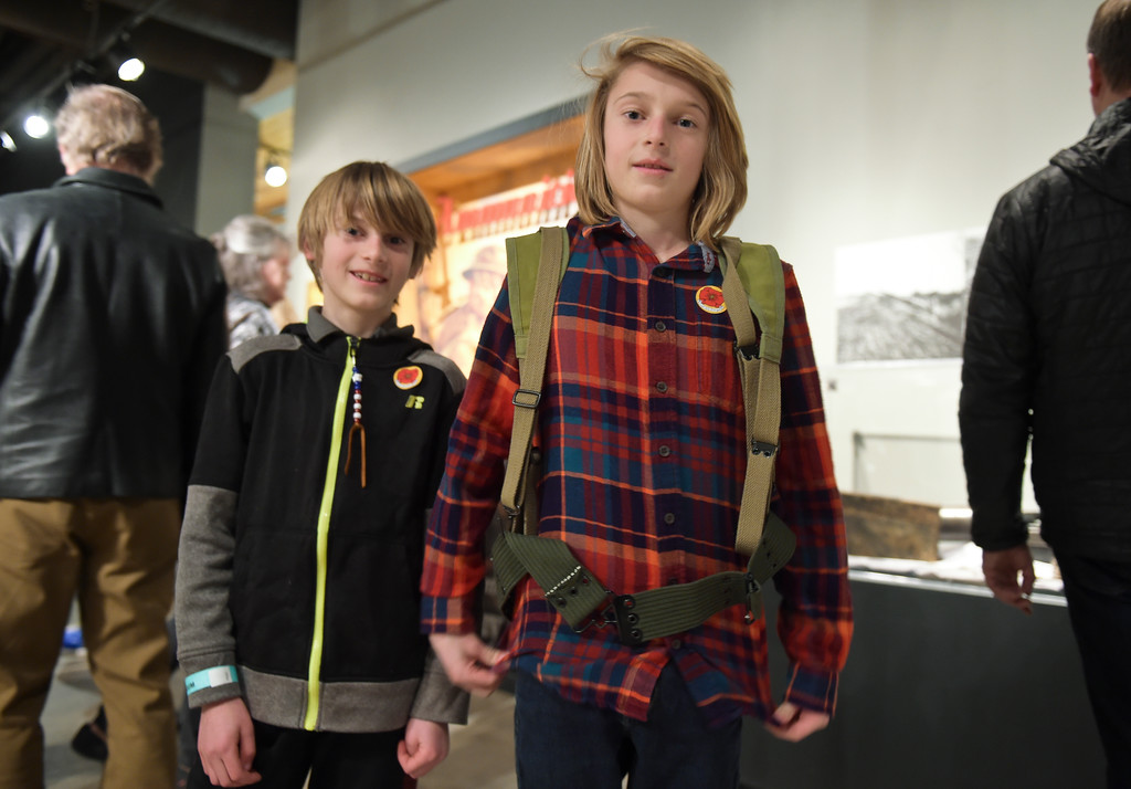 ". Brothers Ezra, 10, and Asher, 12, Sittler tried on a haversack during opening night of ""WW I: Longmont & at the Great War\"" Friday night at the Longmont Museum & Cultural Center, 400 Quail Rd. The exhibit runs through May 13. To view more photos visit timescall.com. Lewis Geyer/Staff Photographer Feb. 02, 2018"