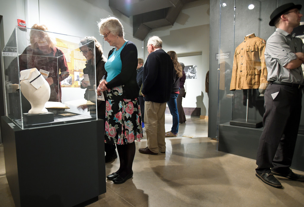 ". Mary Headley looks at a display during opening night of ""WW I: Longmont & at the Great War\"" Friday night at the Longmont Museum & Cultural Center, 400 Quail Rd. The exhibit runs through May 13. To view more photos visit timescall.com. Lewis Geyer/Staff Photographer Feb. 02, 2018"