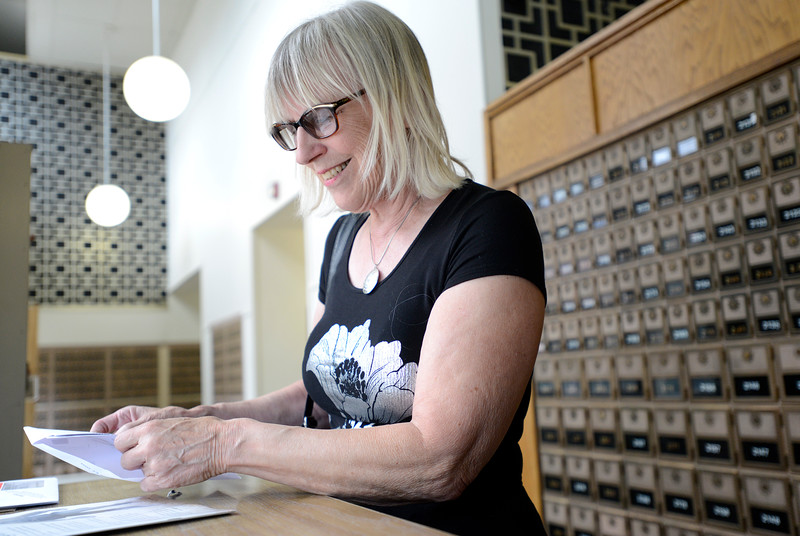 "Sierra Dall opens her mail in the Boulder Main Post Office lobby on Tuesday afternoon. For more photos go to  <a href=""http://www.dailycamera.com"">http://www.dailycamera.com</a><br /> <br /> Devi Chung For The Camera. June 14, 2016"