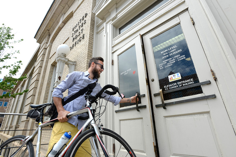 "Sean Kelly enters the Boulder Main Post Office with his bike on Tuesday afternoon. For more photos go to  <a href=""http://www.dailycamera.com"">http://www.dailycamera.com</a><br /> <br /> Devi Chung For The Camera. June 14, 2016"