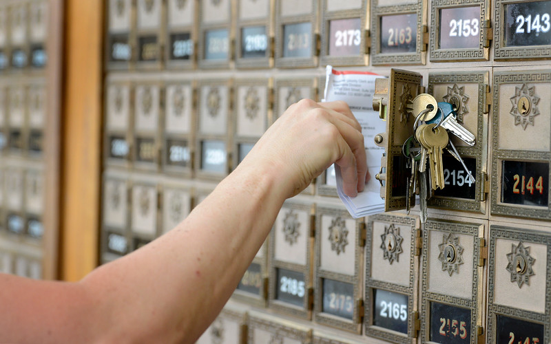 "Michele Guarino reaches for her mail at the Boulder Main Post Office on Tuesday afternoon. For more photos go to  <a href=""http://www.dailycamera.com"">http://www.dailycamera.com</a><br /> <br /> Devi Chung For The Camera. June 14, 2016"
