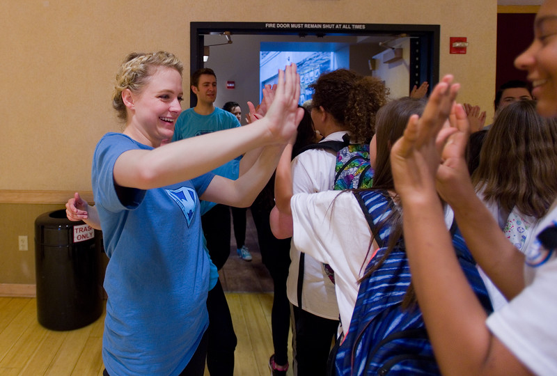 "Kayla Mally, a student with Metropolitan State University of Denver, high fives students after the play ""Water Wise Circa 2016"" during the Water Festival at CU Boulder on Wednesday.<br /> More photos:  <a href=""http://www.dailycamera.com"">http://www.dailycamera.com</a><br /> Autumn Parry/Staff Photographer<br /> May 11, 2016"