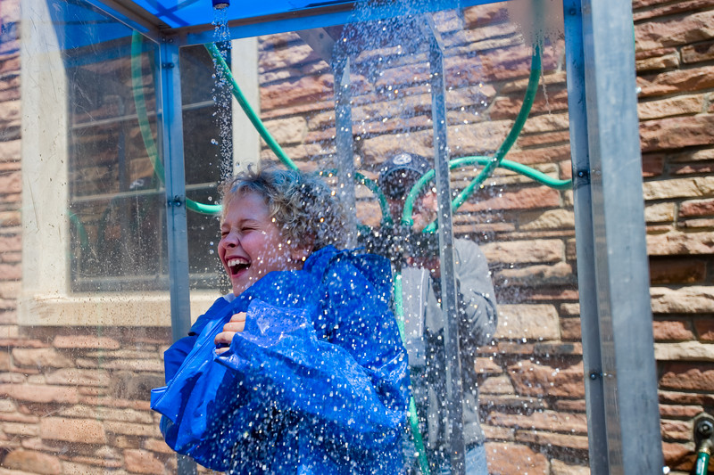 "Logan Gaumond, 11, from Superior Elementary, is sprayed by water during the ""The Wheel of Misfortune,"" a trivial game that teaches the children about floods and storms, during the Water Festival at CU Boulder on Wednesday. The festival showed students from Boulder Valley School District how to conserve and protect water through hands-on activities and presentations.<br /> More photos:  <a href=""http://www.dailycamera.com"">http://www.dailycamera.com</a><br /> Autumn Parry/Staff Photographer<br /> May 11, 2016"