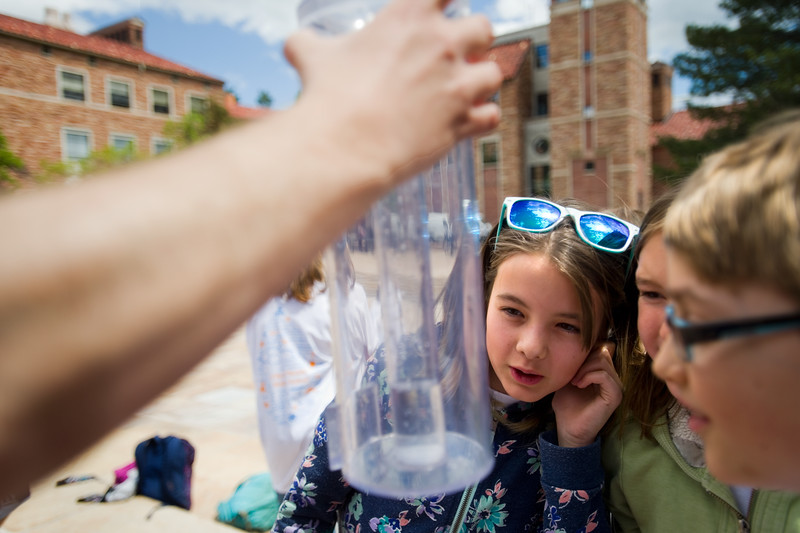 "Voilet Rainwater, from Nederland Elementary, estimates the amount of water in the rain gauge, a device that is used by the National Weather Service to measure precipitation, during the Water Festival at CU Boulder.<br /> More photos:  <a href=""http://www.dailycamera.com"">http://www.dailycamera.com</a><br /> Autumn Parry/Staff Photographer<br /> May 11, 2016"
