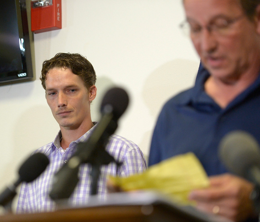 . GREELEY, CO - AUGUST 20: Shanann Watts brother Frankie Rzucek stands behind his father Frank Rzucek while Frank reads from a prepared statement during a press conference Aug. 20, 2018 announcing the charges against Christopher Watts. Watts is suspected of murdering Shanann Watts, who was pregnant, and their two daughters.  (Photo by Lewis Geyer/Staff Photographer)