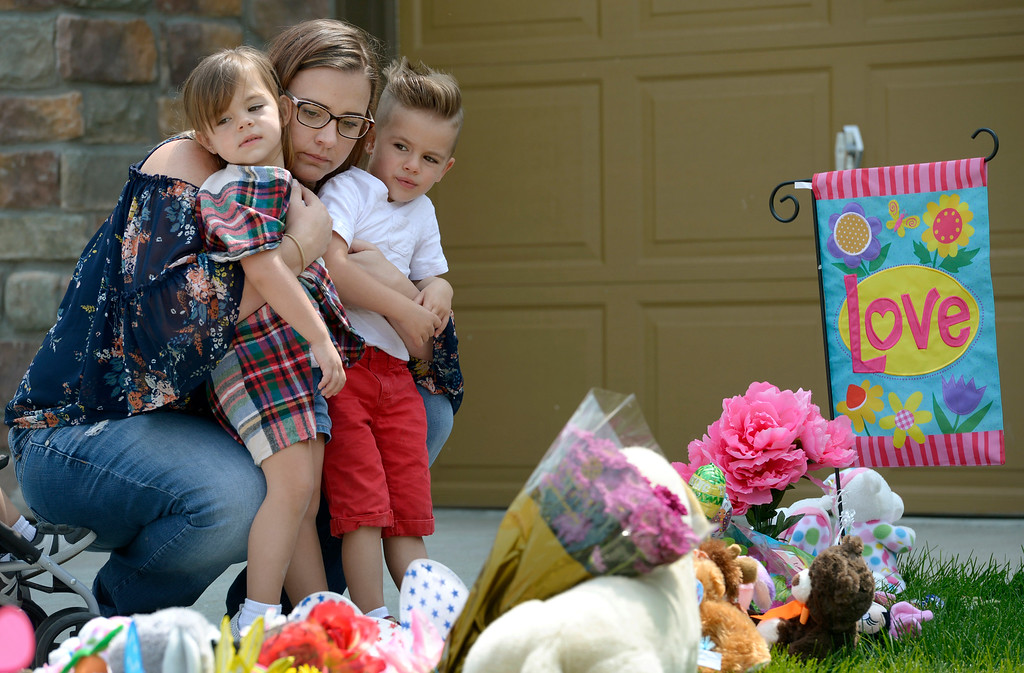 . FREDERICK, CO - AUGUST 20: Cydney Johnson embraces her three year old twins Avery and Roman after placing items at the memorial in front of the Watts\' family home in Frederick Aug. 20, 2018. Also with Cydney was her one year old son Hunter. The Johnsons live in the same neighborhood as the Watts family. (Photo by Lewis Geyer/Staff Photographer)