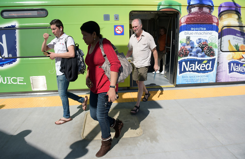 . Riders disembark the train at the RTD Light Rail station in Westminster Tuesday.  Lewis Geyer/Staff Photographer April 18, 2017