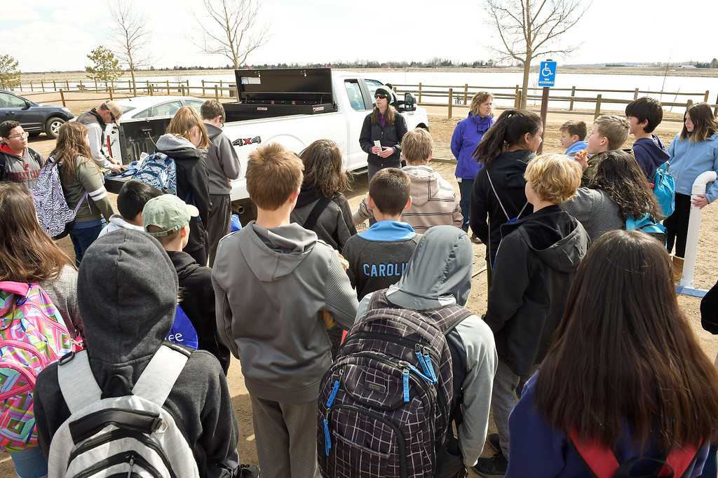 . LONGMONT CO - MARCH 19: Westview Middle School students gather for instructions before installing fishing line collection tubes at Lagerman Reservoir March 19, 2019. A total of three collection tubes will be along the north shore. To view more photos visit timescall.com. (Photo by Lewis Geyer/Staff Photographer)