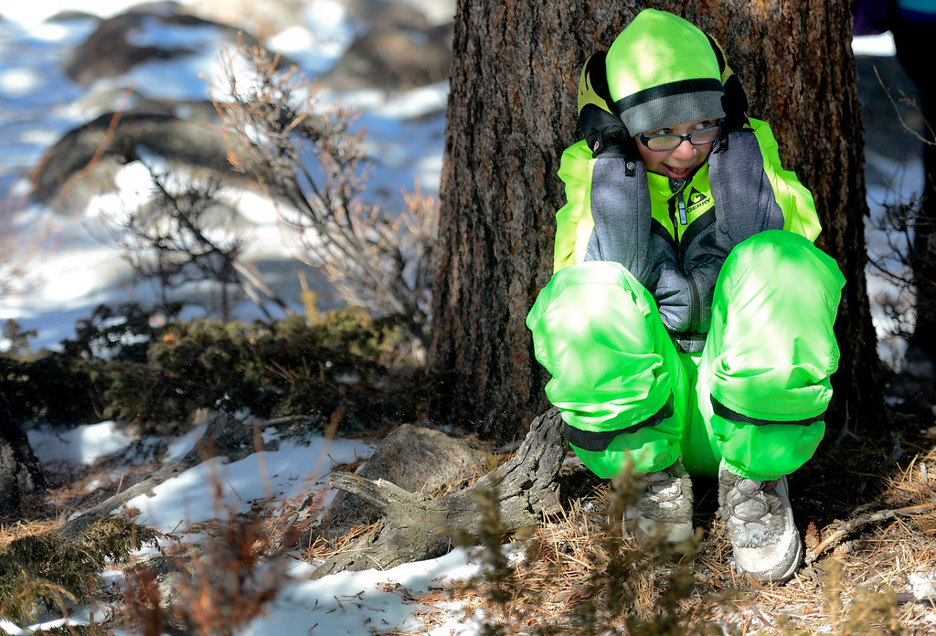 . Westview Middle School seventh grader takes shelter from the wind at Rocky Mountain National Park on Wednesday. More photos: TimesCall.com. Matthew Jonas/Staff Photographer March 1,  2017