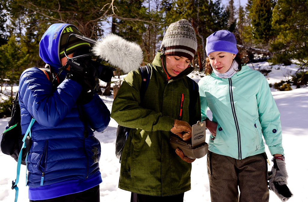 . From right: Westview Middle School seventh graders Sierra Bindseil and Ezra Fehlberg check a game camera while being filmed by Dominic Warner at Rocky Mountain National Park on Wednesday. More photos: TimesCall.com. Matthew Jonas/Staff Photographer March 1,  2017