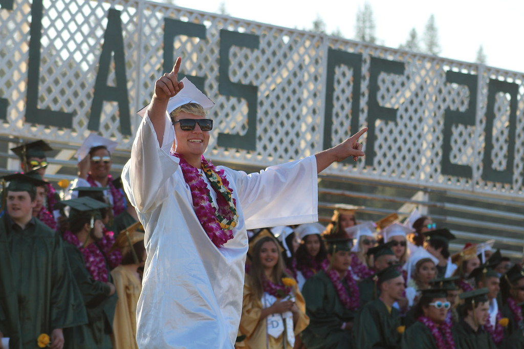 . Daisy Barrett for The Willits News Senior Triston Martin exults during Thursday\'s graduation ceremony at Willits High School