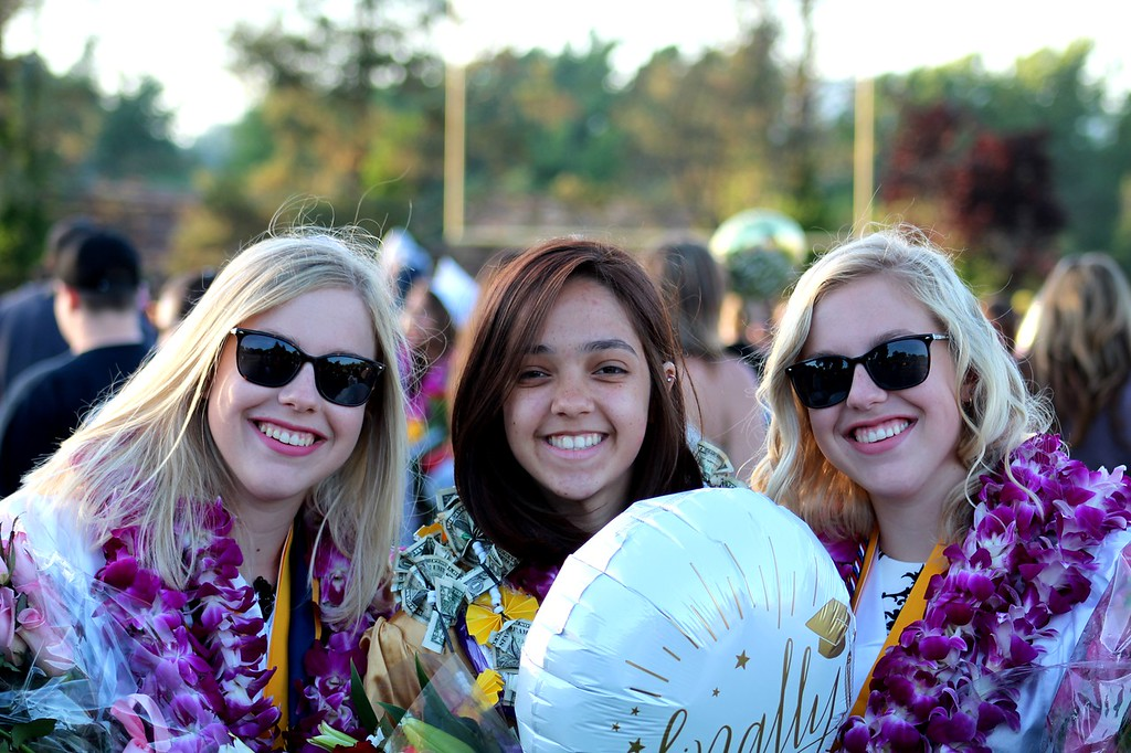 . Daisy Barrett for The Willits News  Sara Strickland, Alexis Reyes, and Naomi Strickland attend the graduation ceremony with peers at Willits High School Thursday.