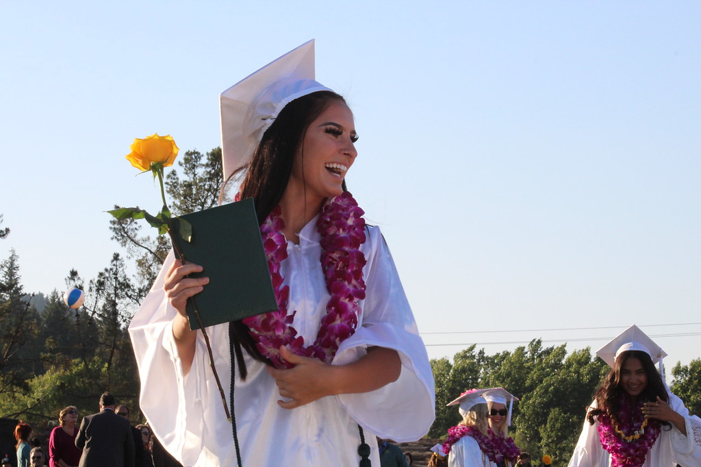 . Daisy Barrett for The Willits News Taylor Polen shares a happy moment with friends and fellow graduates Thursday at graduation ceremonies for the Class of 2018 at Willits High School