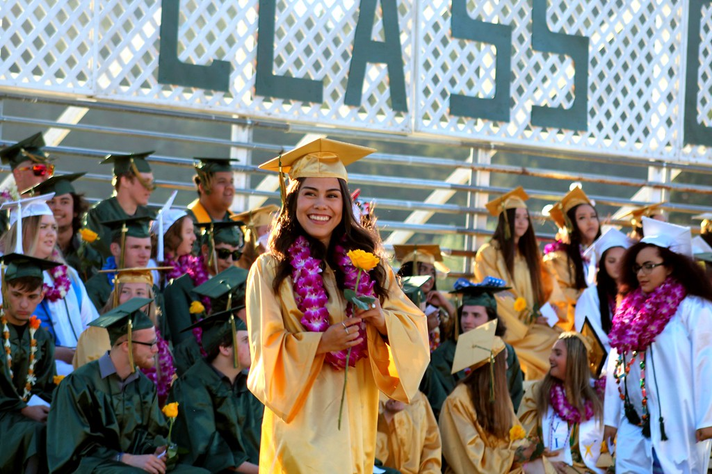 . Daisy Barrett for The Willits News Angelica Gandarilla holds a rose that matches her graduation cap and gown during Thursday\'s ceremony at Willits High School