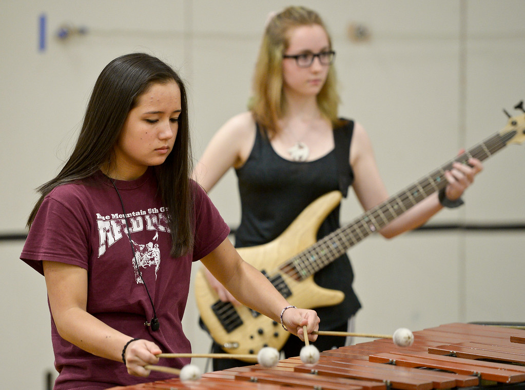 . Silver Creek senior Kendall Lee, left, and Longmont High sophomore Hannah Engholt rehearse Thursday afternoon for the Winter Percussion Drumline competition at Longmont High Saturday. To view more photos visit timescall.com. Lewis Geyer/Staff Photographer March 29, 2018
