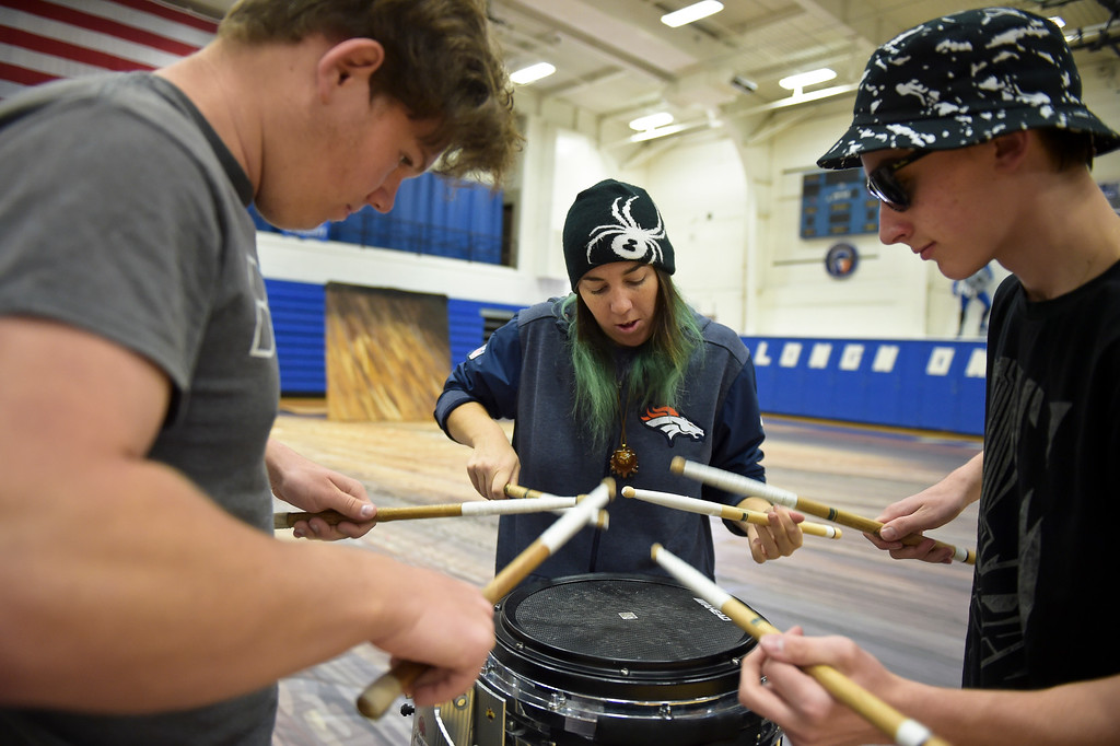 . From left: Silver Creek senior Andrew Heydt, instructor Danielle Savino, and Longmont junior Garrett Dobson rehearse Thursday afternoon for the Winter Percussion Drumline competition at Longmont High Saturday. To view more photos visit timescall.com. Lewis Geyer/Staff Photographer March 29, 2018