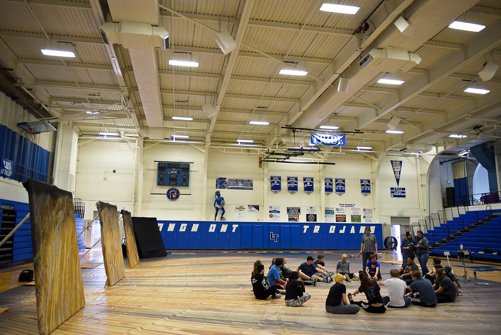 . The Longmont High School drumline stretches at the start of rehearsal Thursday afternoon for the Winter Percussion Drumline competition at Longmont High Saturday. To view more photos visit timescall.com. Lewis Geyer/Staff Photographer March 29, 2018