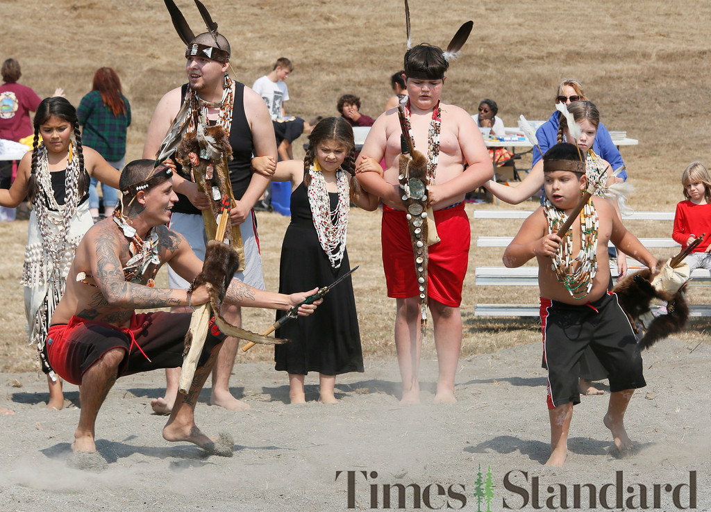 . Shaun Walker � The Times-Standard  Chris Cook and Eddie Bowie, 10, dance at Wiyot Day 2018 on Saturday. The Wiyot Tribe hosts the event annually to provide an opportunity for the community to come together and celebrate Wiyot culture, and to honor elders and veterans. The event was held at Table Bluff Reservation in Loleta and featured dance and cultural demonstrations, a stick game, card game tournament, fresh local wild Chinook salmon dinner, live music, games for kids, and vendors.