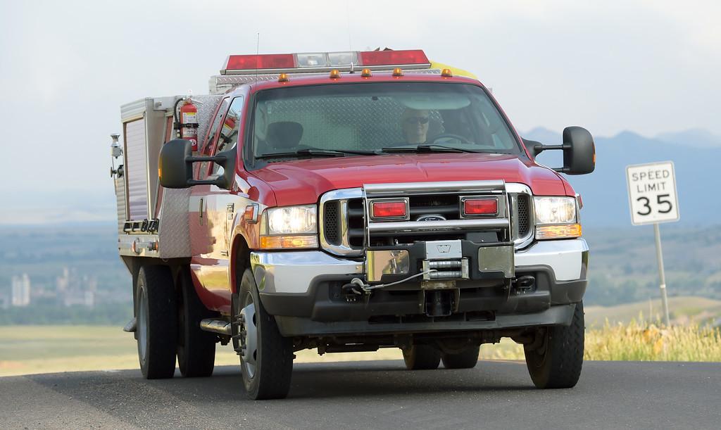 . A Lyons Fire District fire truck returns to a woodland fire in a neighborhood west of Rabbit Mountain near Lyons Friday evening. Lewis Geyer/Staff Photographer June 15, 2018