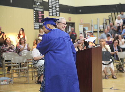 CINTIA LOPEZ - DAILY DEMOCRAT Woodland Adult School Principal Susan Moylan hugs a student at graduation.
