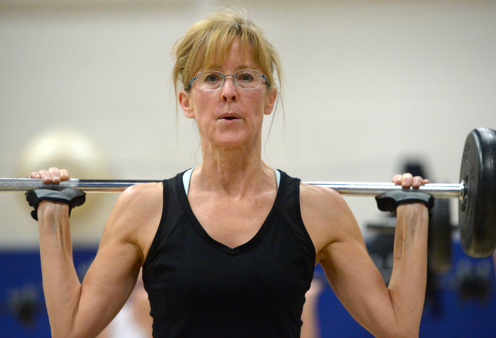 . Kelly O\'Neill uses a barbell during the BODYPUMP workout at the Arapahoe YMCA, 2800 Dagny Way, Lafayette, Wednesday morning. To view more photos visit dailycamera.com. Lewis Geyer/Staff Photographer Dec. 06, 2017