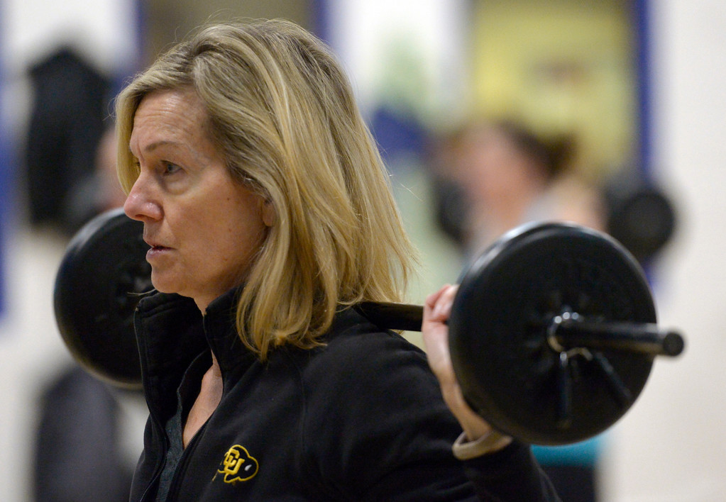 . Kris White participates in the BODYPUMP workout at the Arapahoe YMCA, 2800 Dagny Way, Lafayette, Wednesday morning. To view more photos visit dailycamera.com. Lewis Geyer/Staff Photographer Dec. 06, 2017
