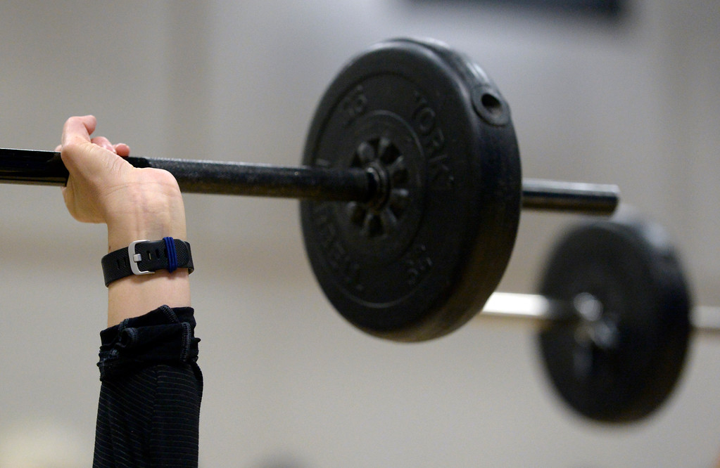 . Barbells are used during the BODYPUMP workout at the Arapahoe YMCA, 2800 Dagny Way, Lafayette, Wednesday morning. To view more photos visit dailycamera.com. Lewis Geyer/Staff Photographer Dec. 06, 2017