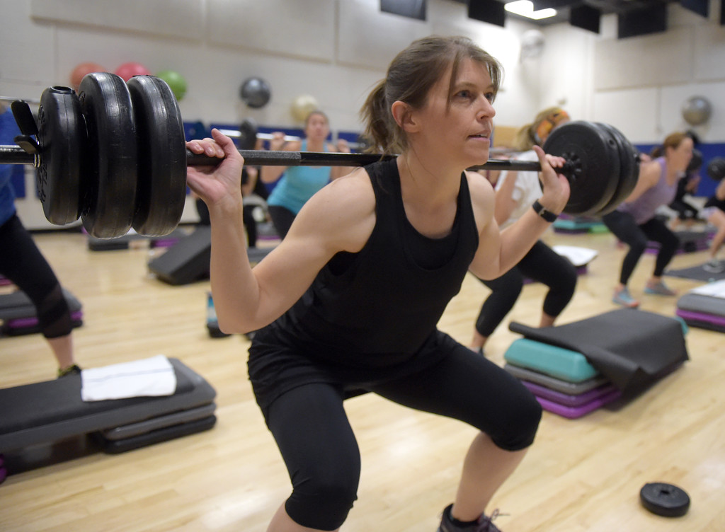 . Tori Guess does squats with a barbell during the BODYPUMP workout at the Arapahoe YMCA, 2800 Dagny Way, Lafayette, Wednesday morning. To view more photos visit dailycamera.com. Lewis Geyer/Staff Photographer Dec. 06, 2017