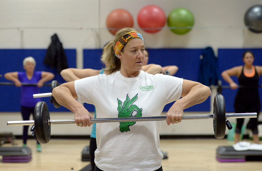 . Karrie Bach warms up with a barbell at the start of the BODYPUMP workout at the Arapahoe YMCA, 2800 Dagny Way, Lafayette, Wednesday morning. To view more photos visit dailycamera.com. Lewis Geyer/Staff Photographer Dec. 06, 2017