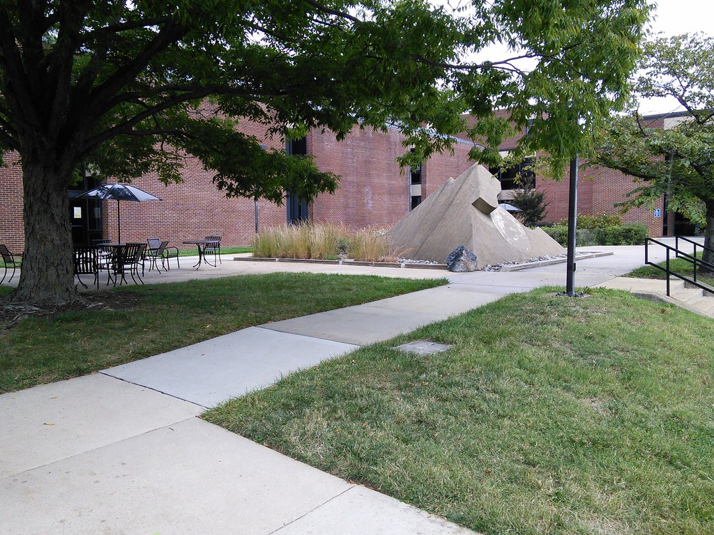 Native planting around the pyramid shaped sculpture at the Architecture Building