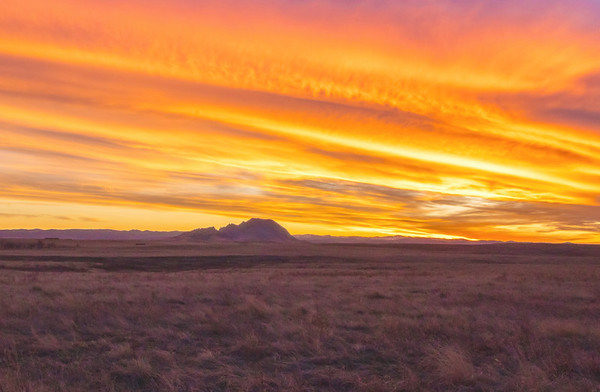 Sunset over Bear Butte