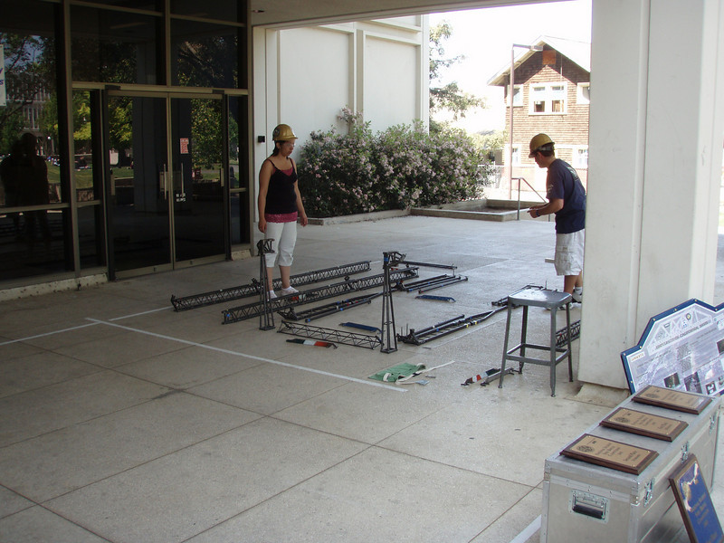 this is another group from another part of the engineering dept. they're racing against the clock to put together a 20' bridge they have fashioned.they are actually moving very quickly. this is a inter-university competition.