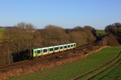 313216 on the 2F65 1310 Brighton to Seaford at Ashcombe Windmill, Kingston near Falmer on the 28th December 2017.
